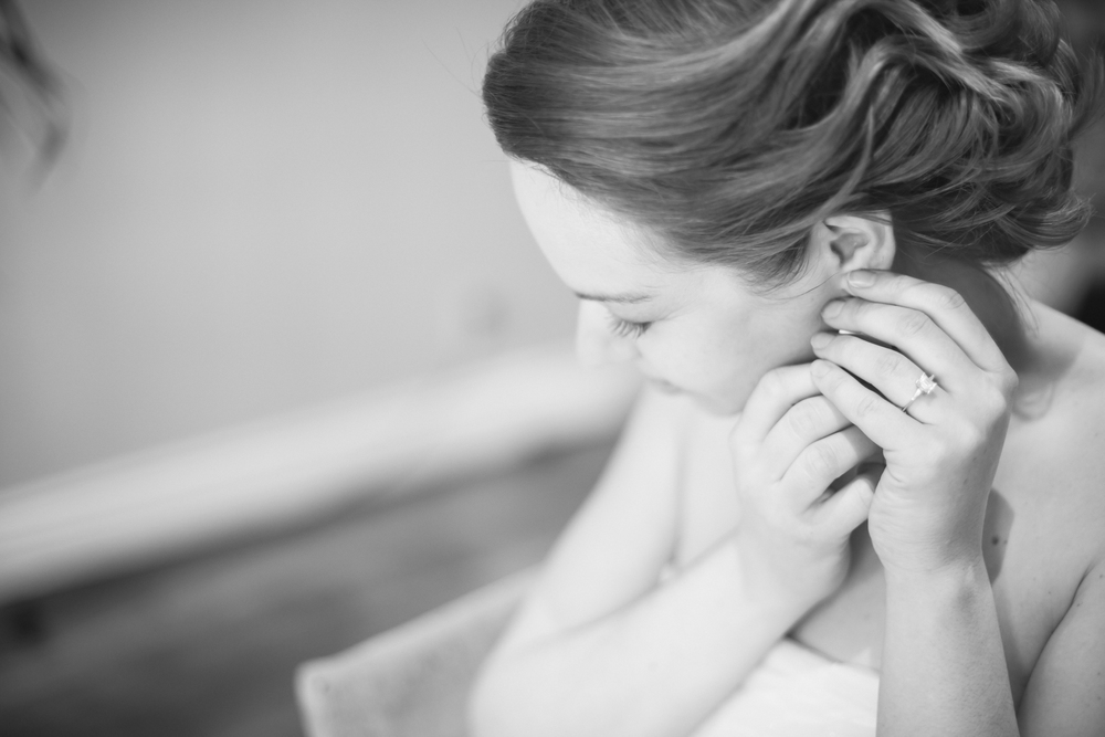 Black and white photo of bride getting ready