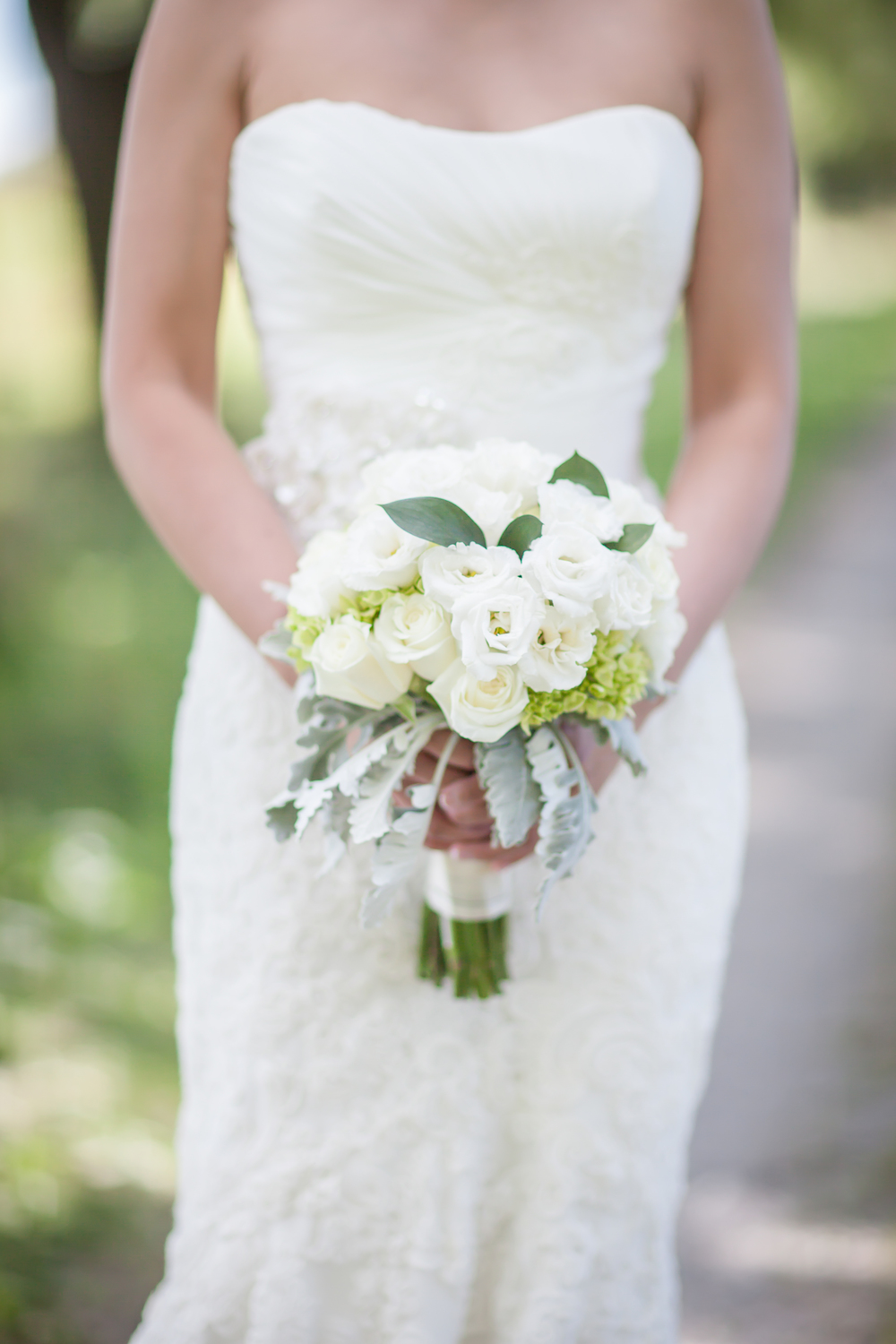 Close up photo of a bride holding her bouquet