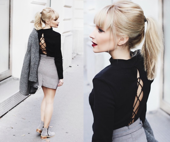 Lace up sweater from behind