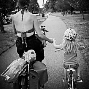 Bikabout-Megan-Ramey-holding-hands-with-daughter-biking