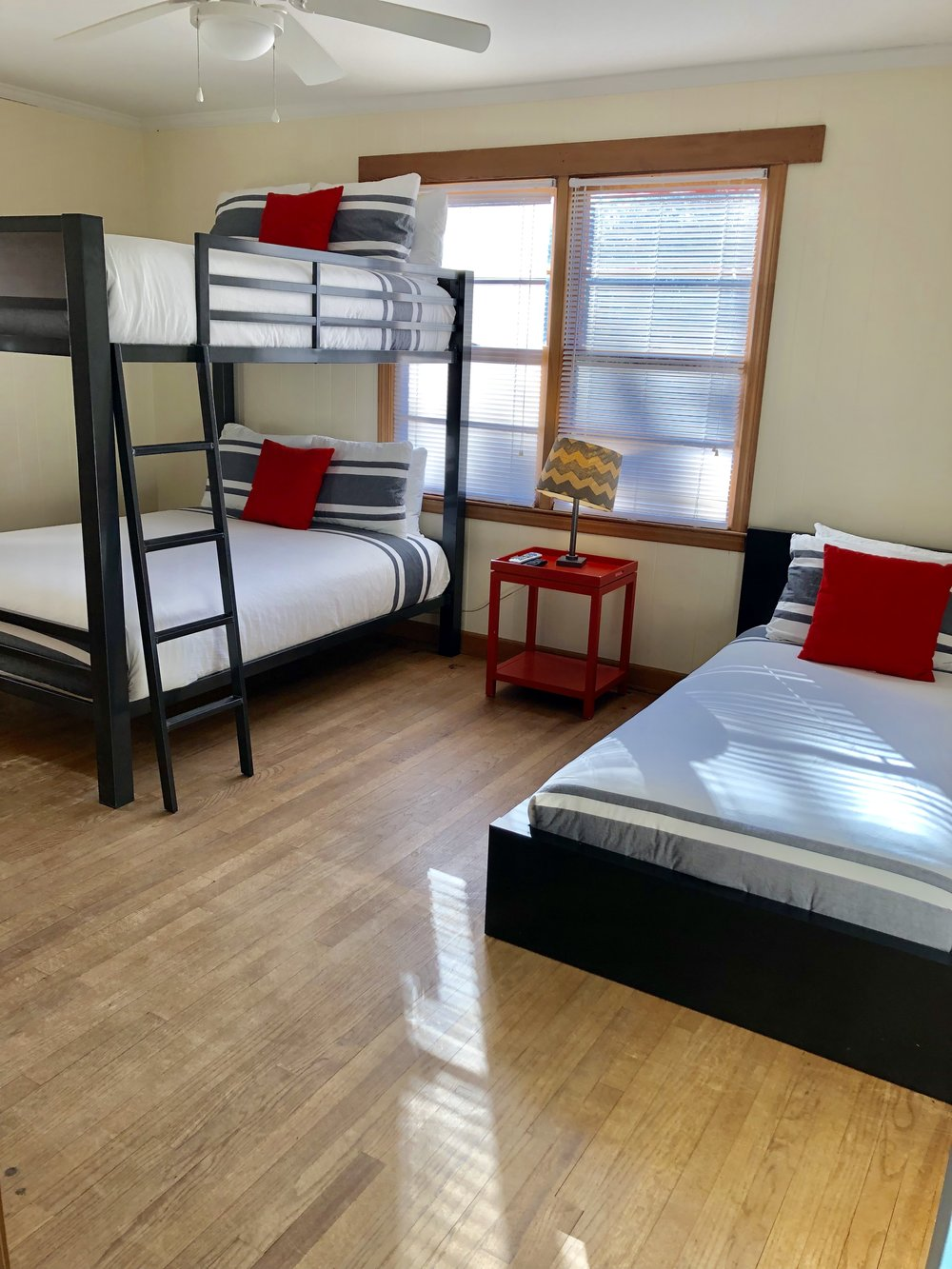 Elroy Room - The Elroy Room has a bunk bed with two full size mattresses and a twin bed, private bathroom with shower stall, TV, Kuerig and access to community kitchen, outdoor decks and hot tub. Sleeps 3-5. Starting at $80/night.