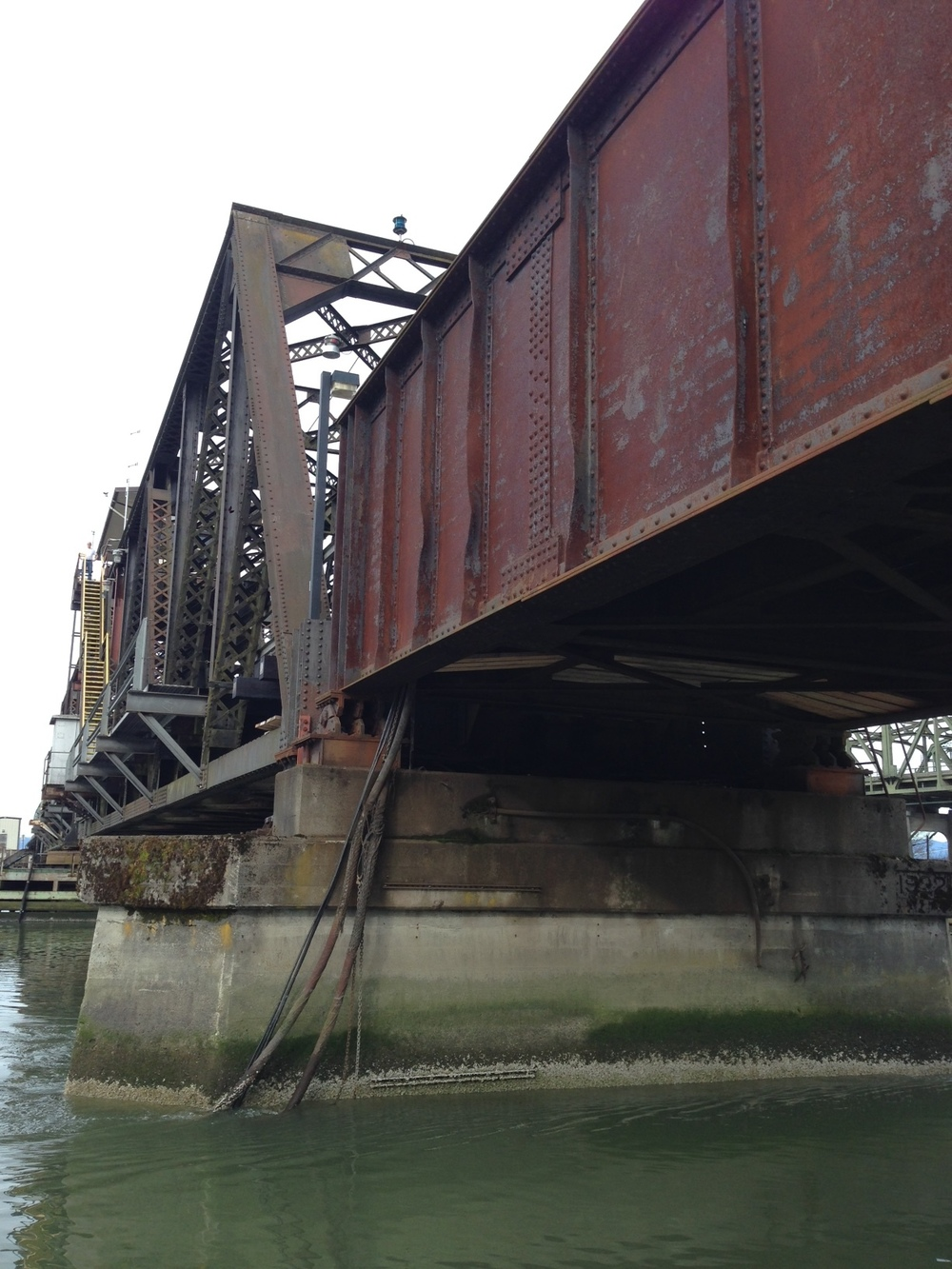 Passing beneath the railroad bridge, which must be done at low tide so as not to scrape the top of your boat.