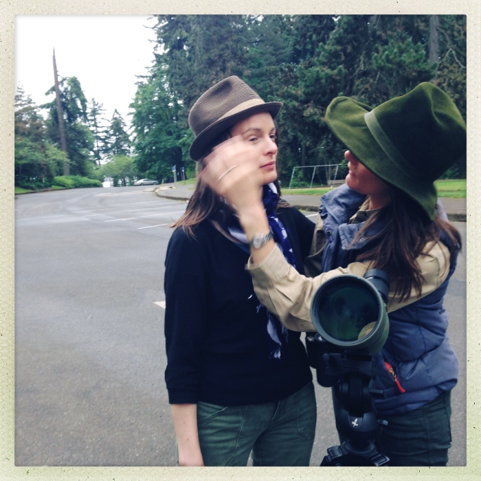 Sis Gilia brushing hair out of my face in front of Jen's scope. Seward Park, Seattle. Beginning a full day of birding at 7:30 a.m.