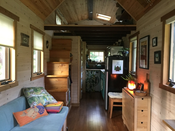 The cozy inside of the tiny house. Mundy's studio area is the counter to the right in the extreme foreground.
