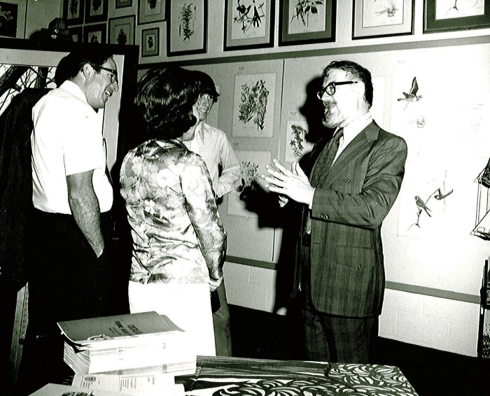 Don regaling admirers in front of his illustrations, mid-1960s. Photo courtesy of Woodson Art Museum.