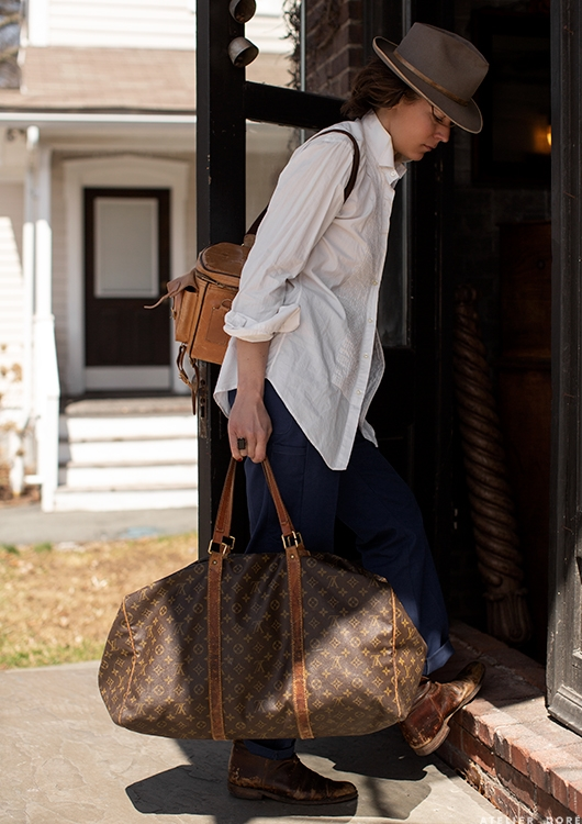 Juliette Hermant from the  Atelier Dore  blog. No, she's not birding, but her kit could be as one! Cross body bag, sturdy shoes, layers on top, and a fedora.