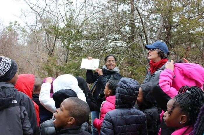 Adams leading a bird walk for New York City Audubon in Floyd Bennett Field, 2014. Courtesy of Tiffany Adams.