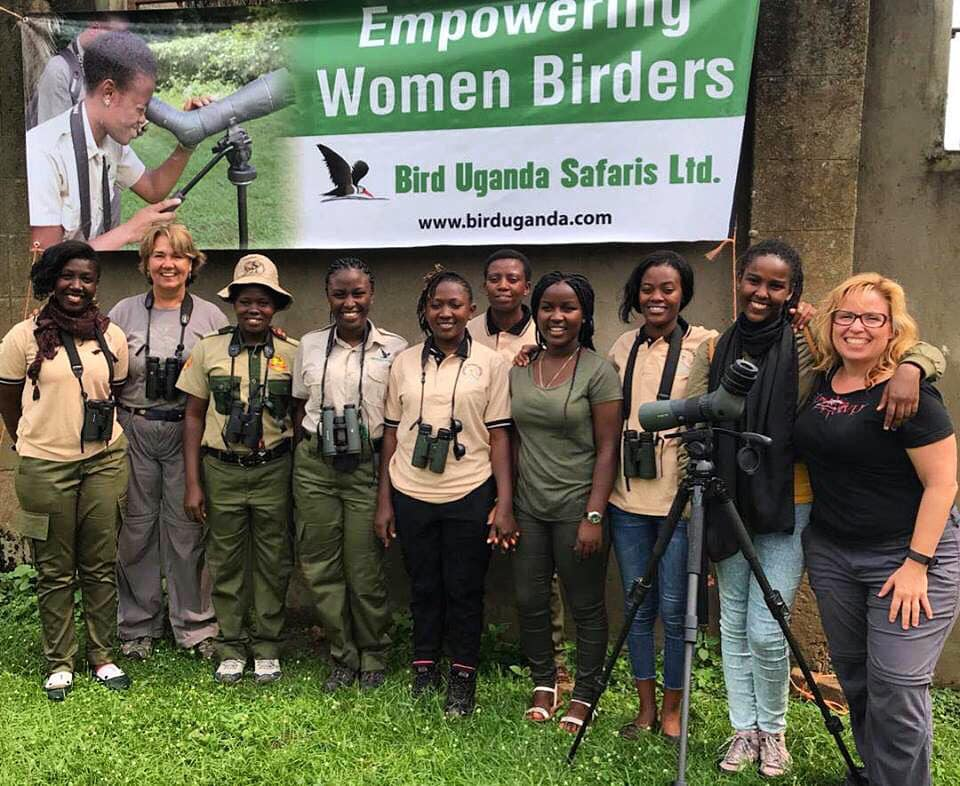 "Women birding guides unite at the African Birding Expo, 2018. Left to right; Munyantwali Christine, Megan Crewe, Prossy Nanyombi, Judith Mirembe, Veronica Nakafeero, Lilian Kamusiime, Jeanisse Nsanga, Abia Atukwatse, Pamela ""Waxbill"" Giramata Gasana and Sharon ""Bird Chick"" Stiteler, December, 2018. Photo by Herbert Byaruhanga."