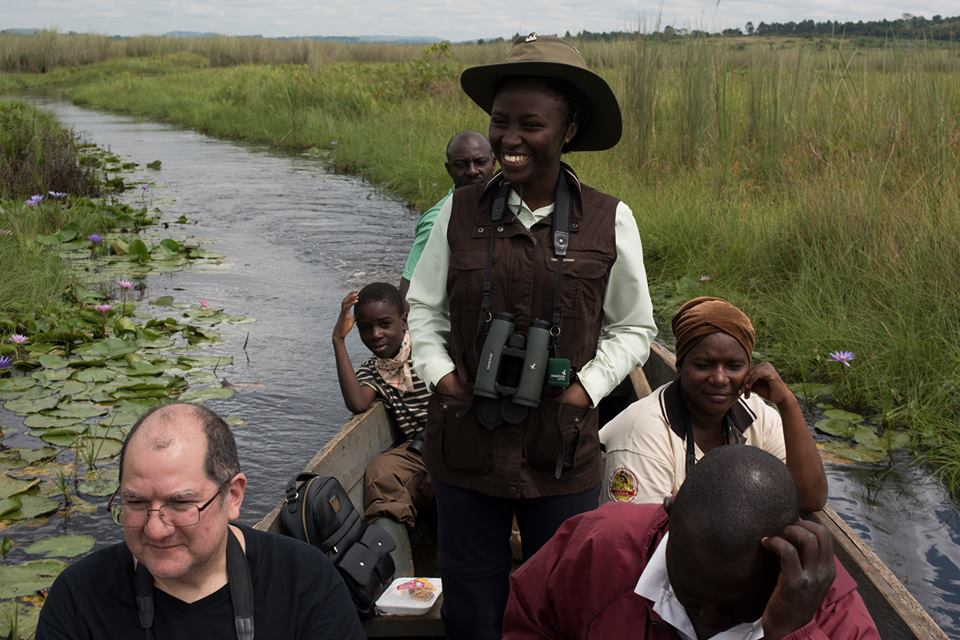 Mirembe with American client Ross Hugh and local guides at the Mabamba wetlands.