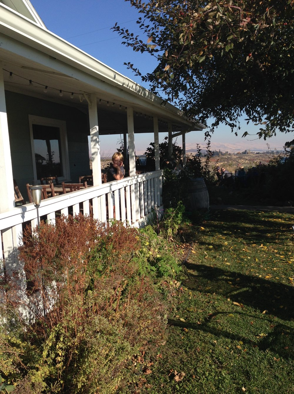 The dreamy covered porch of the Wilridge Winery farmhouse outside Yakima, WA.