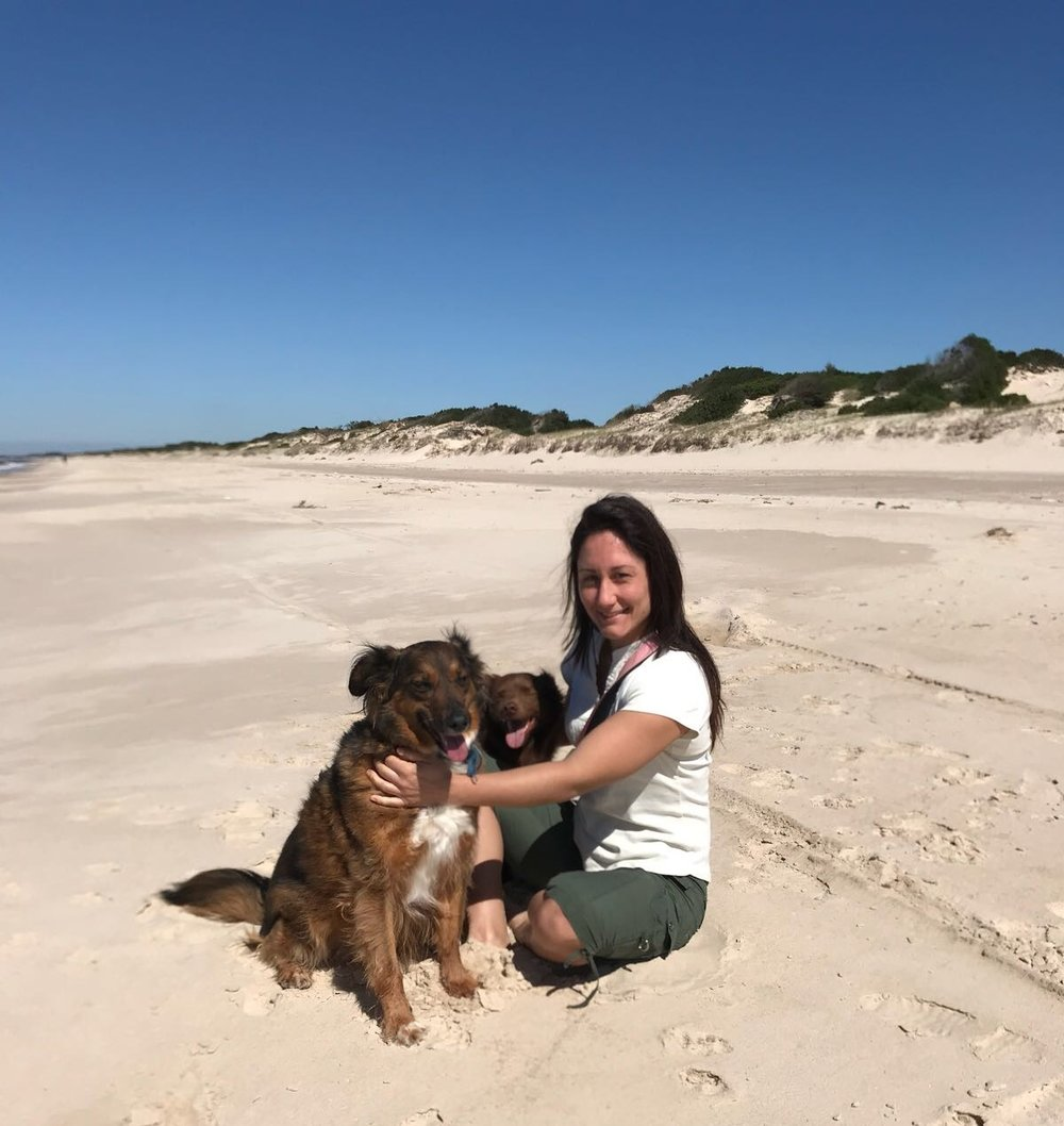 Ocampo on her home beach with her dogs Chicha and Choco.