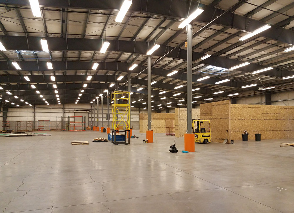 Warehouse floor. The right side of the building are the production rooms: paint booth, drying room, metal shop and wood shop.