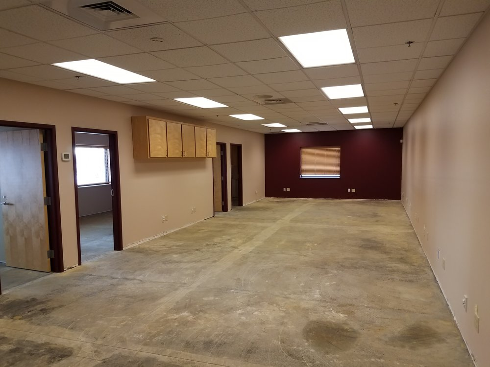 The sales office just needs some sprucing with new carpet and partition walls.