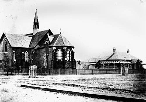 Showing the original apsidal Chancel, from corner of Mort St. + old Rectory. circa 1872 (src: Qld State Library)