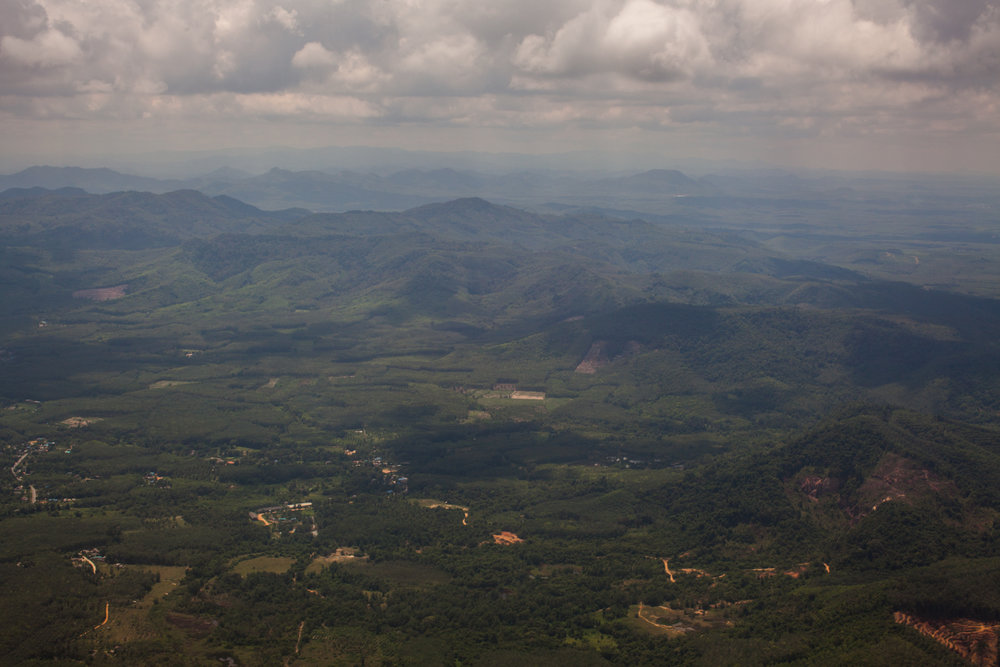 "The lush green Sankalakhiri mountain range, seen here while approaching Hat Yai airport, stretches south from Songkhla province in Thailand to Negeri Sembilan in Malaysia. Also known as ""Banjaran Besar"", or ""Big Range"" by locals, it is the mountain range that forms the backbone of the Malay peninsula."