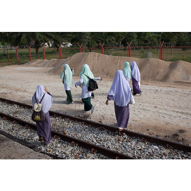 School children make their way home from Tanjong Mat train station in Narathiwat province in Thailand's deep south. They attend an Islamic school in another district and the train is their only transportation option. The train is run by the government and is free for locals. However is has come under frequent attacks from the insurgents. #dailylife #thaimalaysiaborder #train #islam #thaideepsouth #conflictzone #conflictreporting #narathiwat #thailand #kingdomsedgebook #kingdomsedge #selfpublished #selfpublishedauthor #malay #ethnicmalay