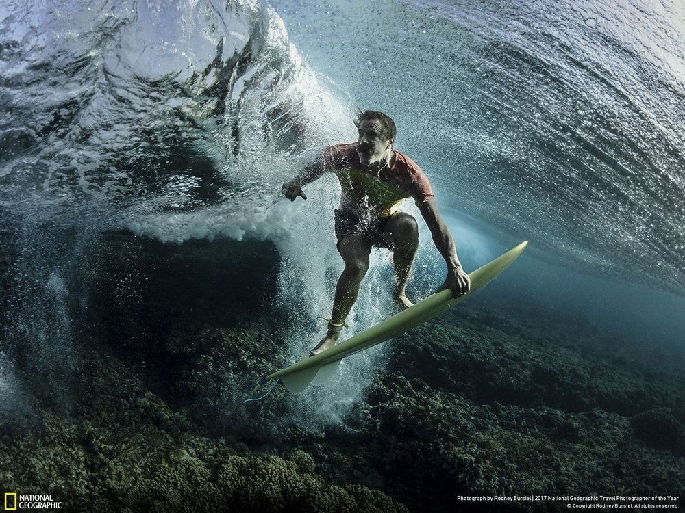 Under the Wave •• Photo and Caption by Rodney Bursiel I recently traveled to Tavarua, Fiji to do some surf photography with pro surfer Donavon Frankenreiter at Cloudbreak. I'm always looking for new angles and perspectives. The usual surf shots have all been done so we decided to get a little creative. Makes you look twice.