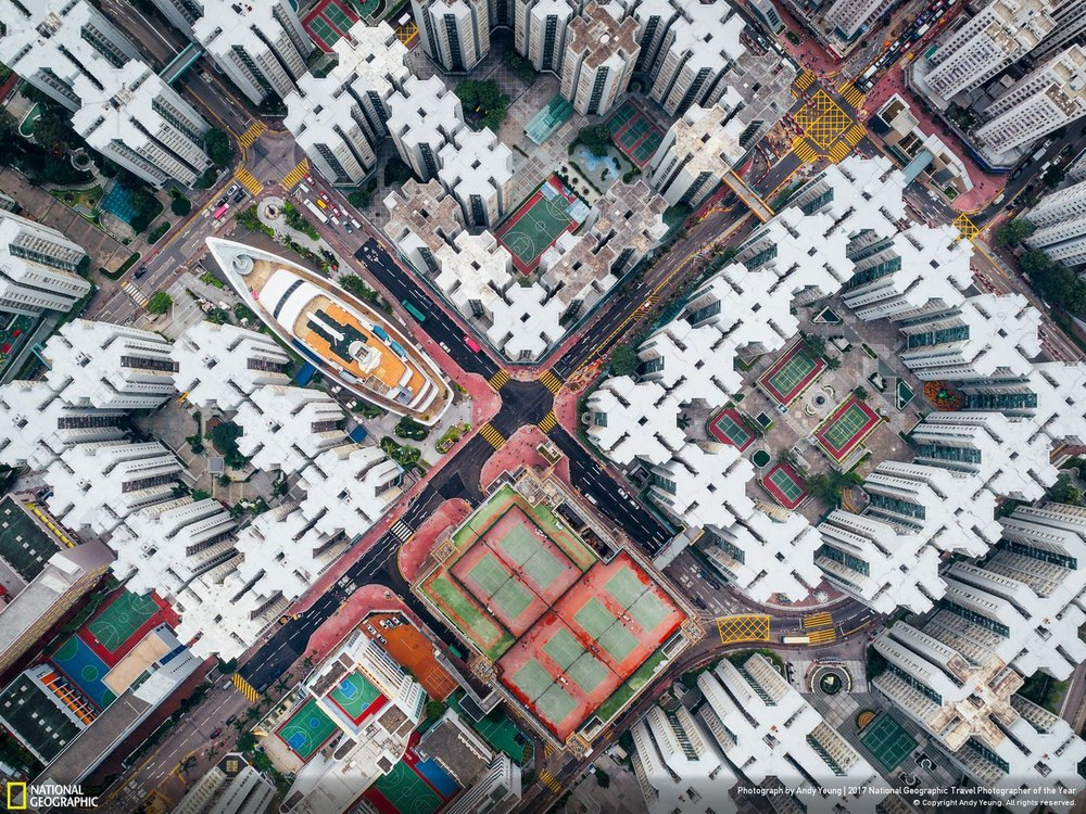 Walled City #08 •• Photo and Caption by Andy Yeung The Kowloon Walled City was the densest place on Earth. Hundreds of houses stacked on top of each other enclosed in the center of the structure. Many didn't have access to open space.This notorious city was finally demolished in 1990s. However, if you look hard enough, you will notice that the city is not dead. Part of it still exists in many of current high density housing apartments. I hope this series can get people to think about claustrophobic living in Hong Kong from a new perspective.