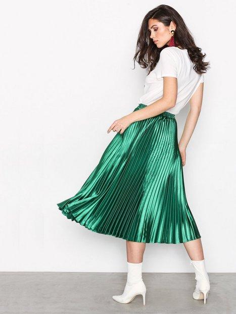 Plisserad kjol , Nelly