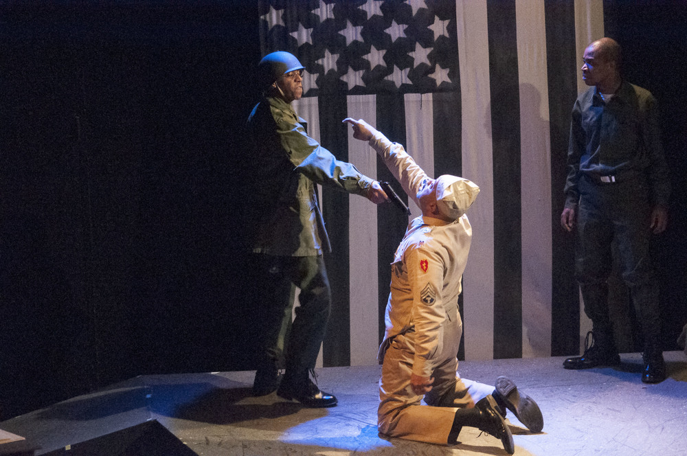 The climax of the play, where Private Peterson (Lynn Andrews) unexpectedly shoots  Sergeant Water  s ( Hassan El-Amin) .
