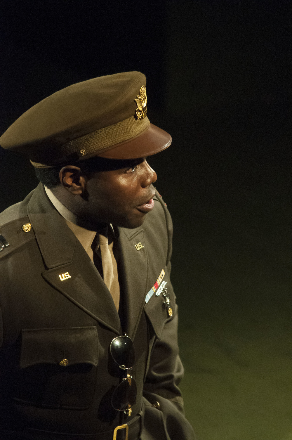 Captain Richard Davenport (Christopher Dontrell Piper) during his opening monologue.