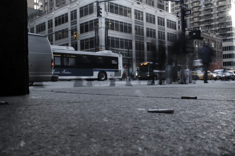 A time-lapse photo of discarded cigarettes and the people of New York City.