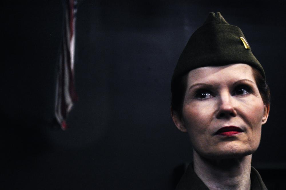 Lieutenant Victoria Lawson (Mary-Margaret Pyeatt) stares off at the three nurses.