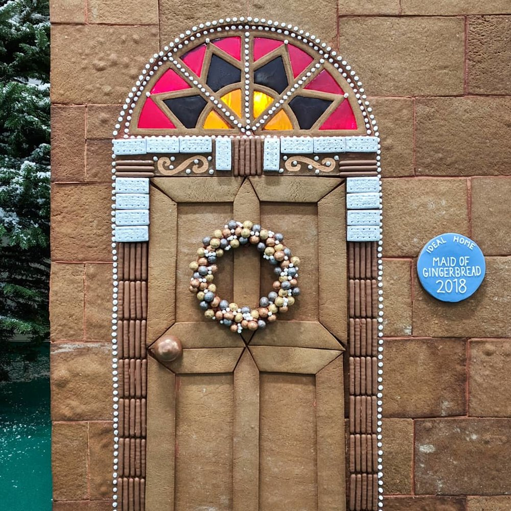 LIFE-SIZE GINGERBREAD TOWN HOUSE  Created for display at The Ideal Home Show at Christmas, a gingerbread replica London town house with lollipop window boxes and stained sugar glass windows.