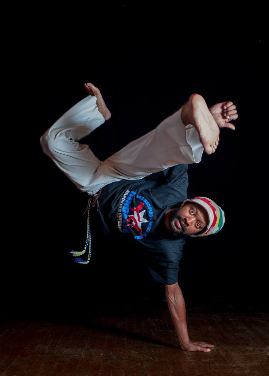 "Eric ""E"" Johnson (Instrutor Frade)  began training   capoeira in his native Chicago with Mestra Marisa in 1996.    He earned his blue Instrutor cord in 2016.    He taught classes in Chicago at Old Town School of Folk for 10   years before moving to Vermont with his family in 2014.  He began teaching capoeira classes in the Upper Valley as an extension of Mestre Marisa's group Gingarte Capoeira Chicago."