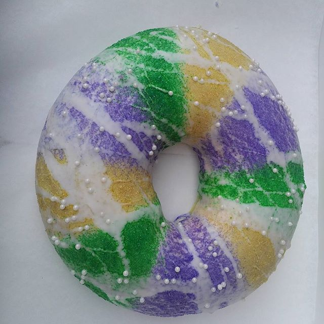 Looks more like a piece of art than a King Cake. Be sure to get your Mardi Gras orders in now for one of our yummy cakes. Will YOU be lucky enough to be served the hidden baby???