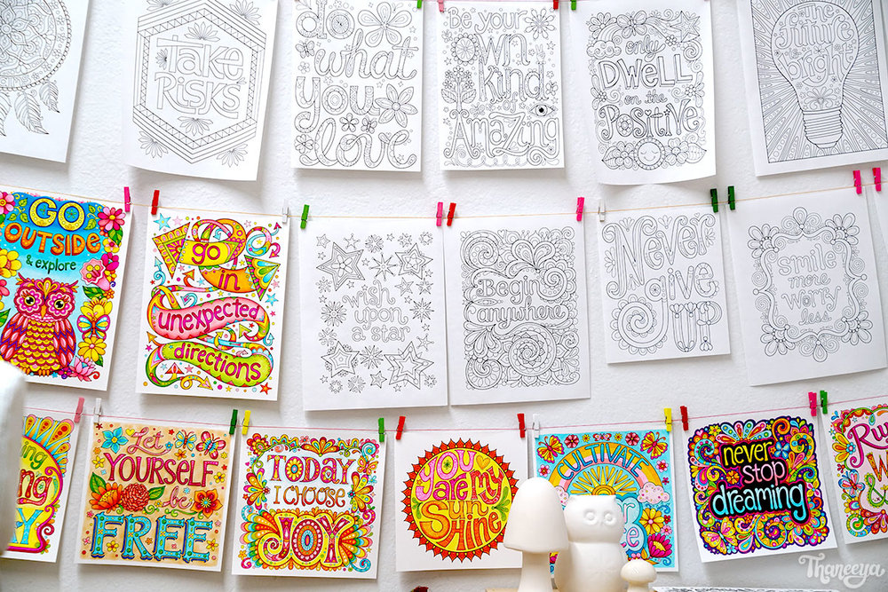 Thaneeya McArdle's art wall of coloring pages from her More Good Vibes Coloring Book