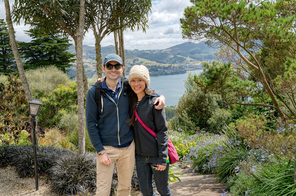 Thaneeya McArdle andher husband Marcus on the grounds of Larnarch Castle in New Zealand, overlooking Otago Harbour