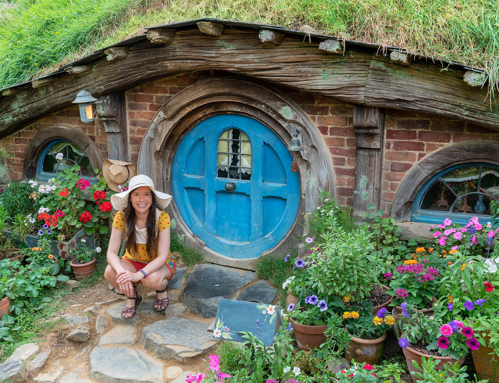 Thaneeya McArdle in front of a Hobbit home in Hobbiton