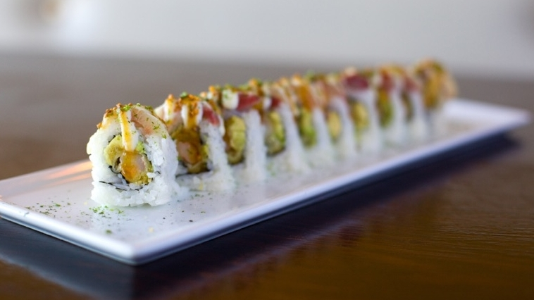 G.Q. Roll — $12.95   Tempura shrimp, avocado, cream cheese topped w/ BBQ eel & unagi sauce