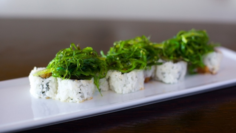 Poki Roll – $9.25  Spicy Tuna Roll topped w/ Seaweed Salad