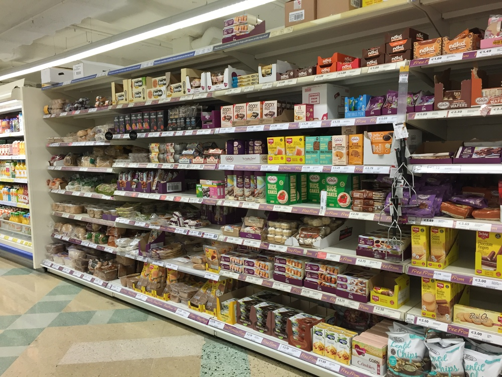 More GF options in this dedicated aisle at Tesco  than could fit in one picture and it was not the only section.