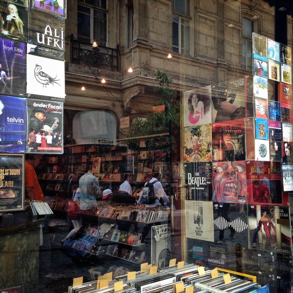 A music store with vintage vinyl records in Tunel of Istiklal, the roughly mile long wide pedestrian avenue in Beyoglu lined with shops and gorgeous old buildings like the one in the reflection.