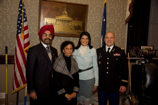 Our governor, her parents, Ajit and Raj, and her husband, Michael.