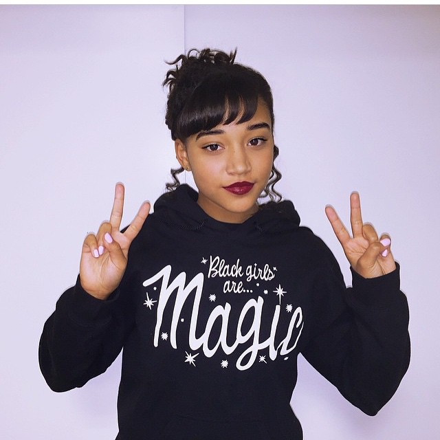 "Actress Amandla Stenberg wearing a sweatshirt that says ""Black Girls Are Magic."""