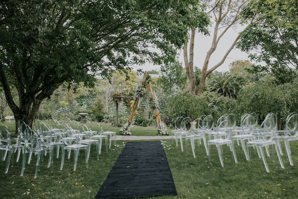 Wedding   Marquee & Furniture Hire. Ghost Chairs at Ceremony, Tauranga.