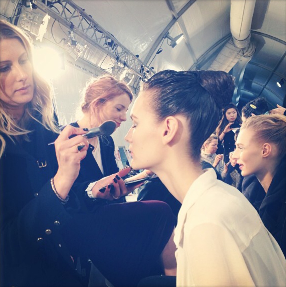 Stoj at work, backstage at a DIOR show.