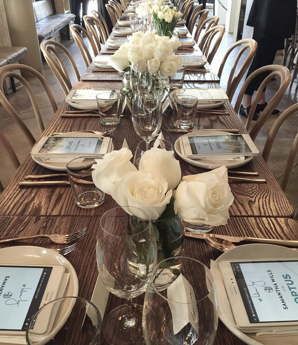 Table setting detail for the media launch, where every guest got a white SAMSUNG tablet. Image via @KateWaterhouse7
