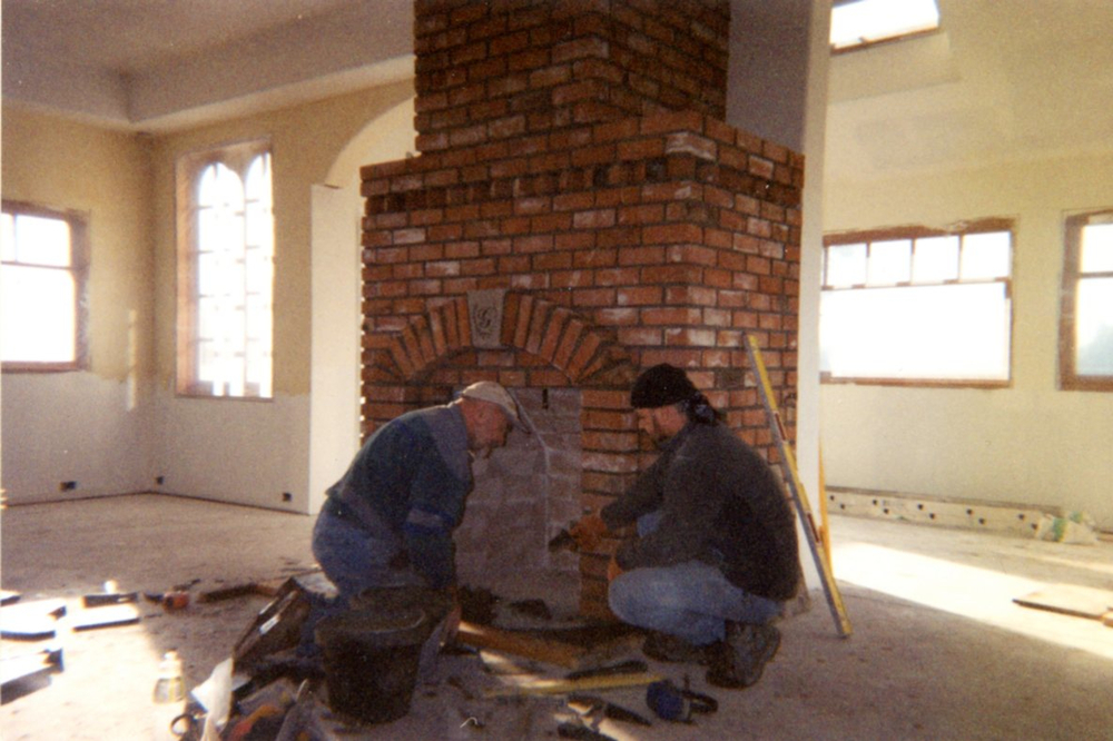 Laying the brick for the Rumford-style fireplace