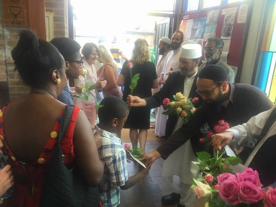 Distributing flowers at Holy Ghost Catholic Church.