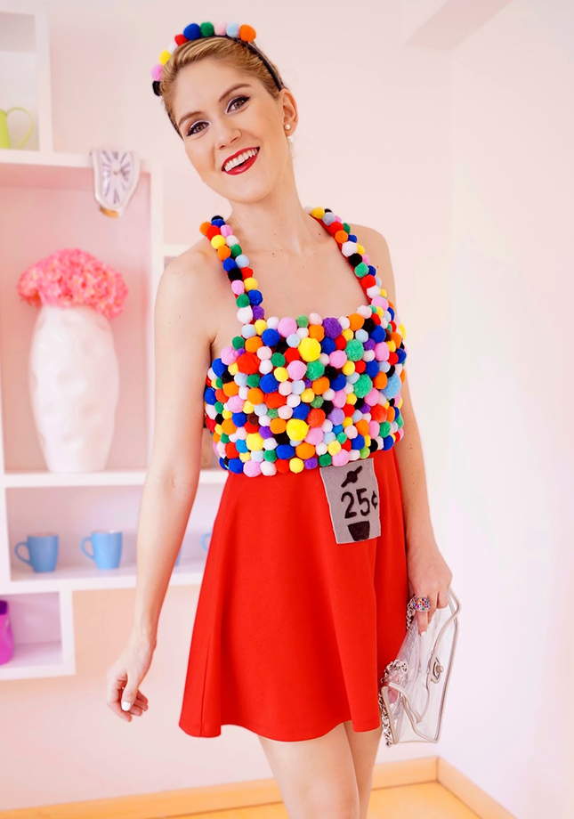 Bubble Gum Machine  : This may look complicated, but it's actually deceptively easy. All you need is a red skirt, a big bag of colored pom poms and a shirt to glue them too. (via   The Joy of Fashion  )