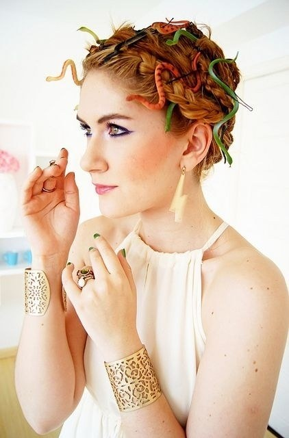 Glue toy snakes onto bobby pins and add to your hair for a last-minute Medusa look.  Wear some gold accessories and a long, flowy dress for the full effect. ( via The Joy of Fashion Blog )