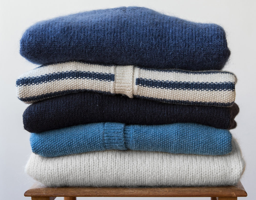 To store your jumpers it is advisable to fold them so they keep their shape. Woolen garments must not be hanged because the wool could lose its shape. Fold them and store them in a space with a moth-repeller.