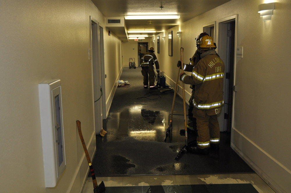 rolling-green-apartments-firefighters-cleaning-up-waterjpg-494a8a6e0d9f8ecc.jpg