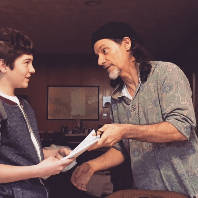 Jeffry and his youngest son Dominic discussing the progress of the Kumar book manuscript.