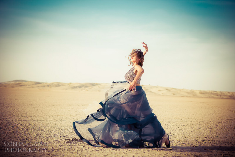 San Diego Fashion Photographer - Portrait of a Woman Dancing in California Desert.